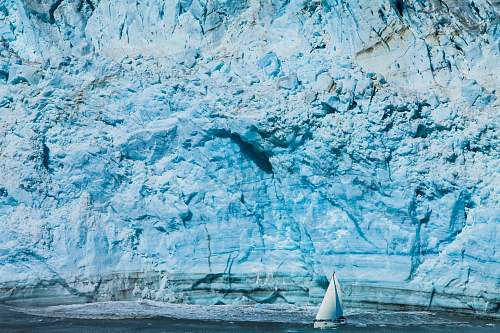 nature white sailboat near mountain glacier