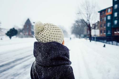 beanie woman standing on snow covered road hat