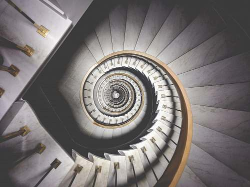 spiral photo of spiral white stairs architecture