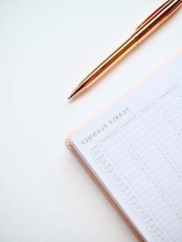 pen white and black yearly planner notebook planner