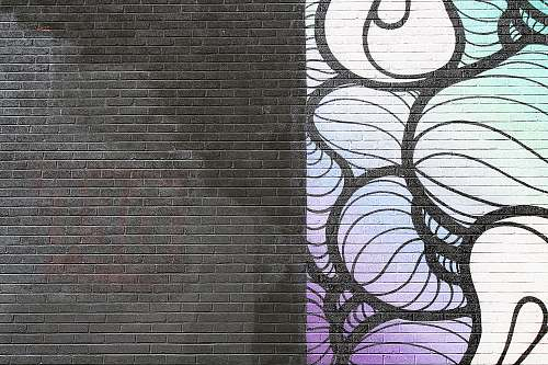 brick black, white, and purple abstract artwork wall