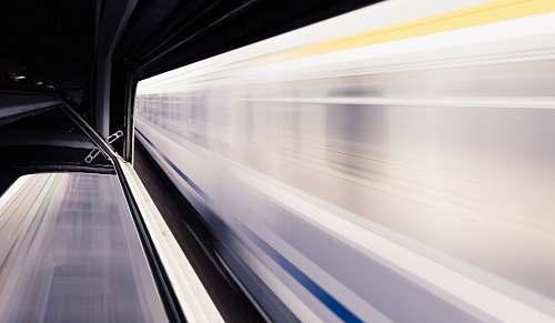 transportation timelapse photo of white train and subway station subway