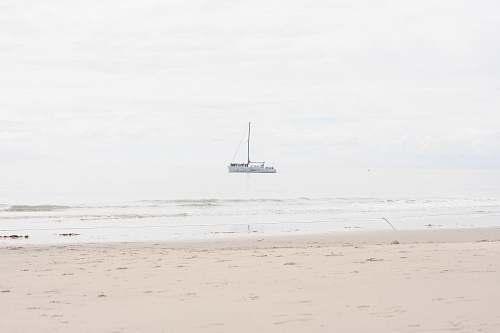 boat boat near shore during daytime vehicle