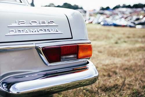 car tilt shift lens photo of 280 SL automatic car bumper
