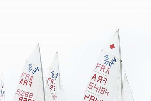 vessel white and red sailboat sails watercraft