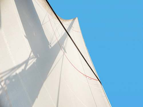 boat white building in low-angle photography sailboat