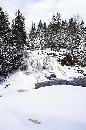 fir waterfalls between trees abies