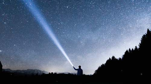 switzerland silhouette of person holding flashlight during nighttime night