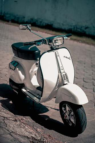 vespa white and black motor scooter scooter