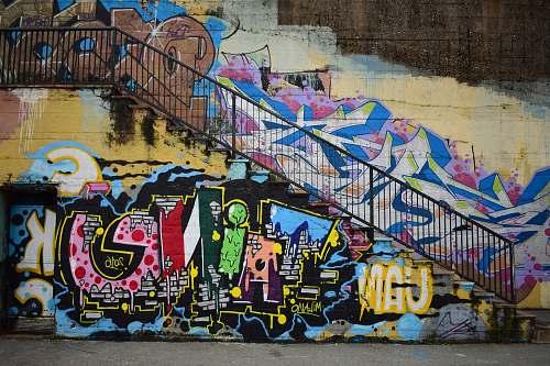 graffiti photo of white, pink, and blue graffiti railing