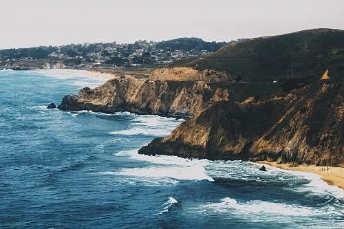 coast aerial photo of beach cliff