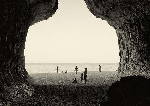 shoreline grayscale photography of people on seashore sea