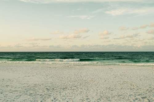 beach photography of calm beach side sea