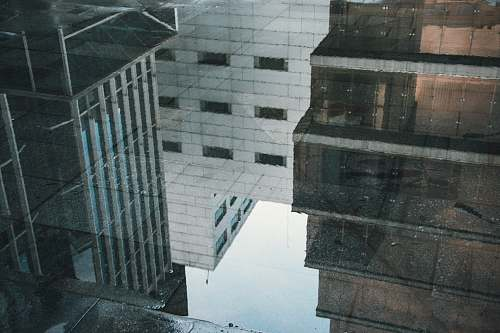 buildings reflection of buildings in water on floor reflection
