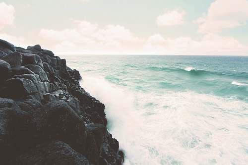 rocks rocky cliff beside the ocean grey