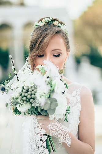 human bride smelling the flowers people