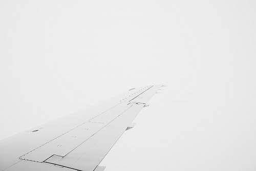 black-and-white aerial photography of airplane wing diagram