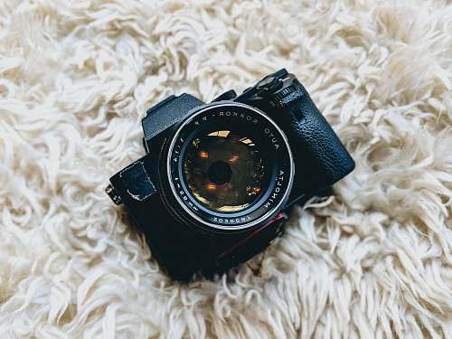 goggles black milc camera on white fur cloth minolta