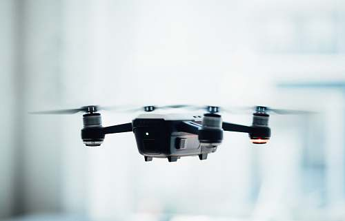 drone black quadcopter drone selective focus photograph fly