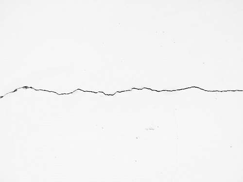 black-and-white crack on surface drawing