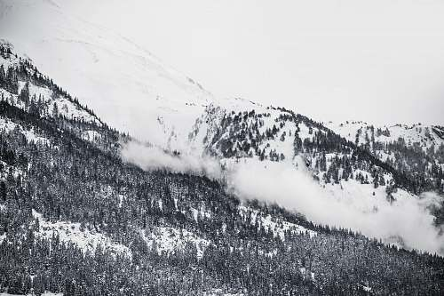 mountain grayscale photography of snowy mountain clouds
