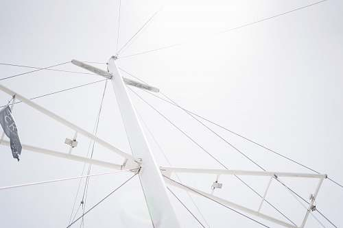 antenna low-angle photography of white metal tower electrical device