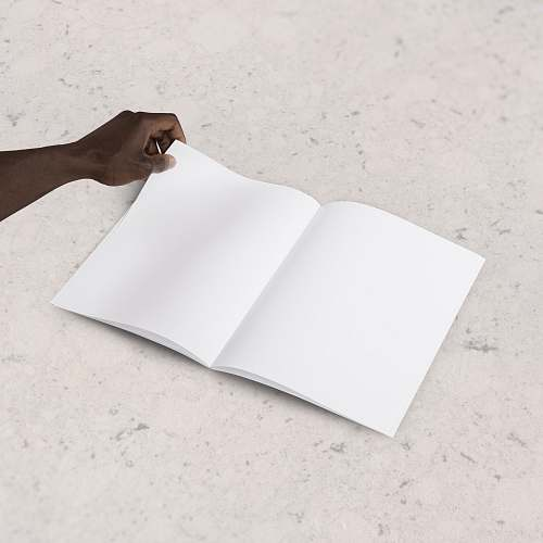 paper person holding blank book page minimal