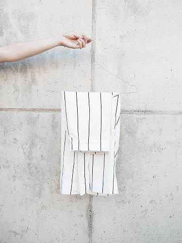 fashion person holding hanger with white shorts paper