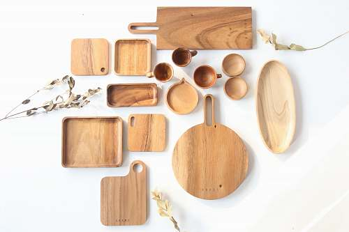 plywood top view of assorted shape and sized wooden kitchen utensils wood