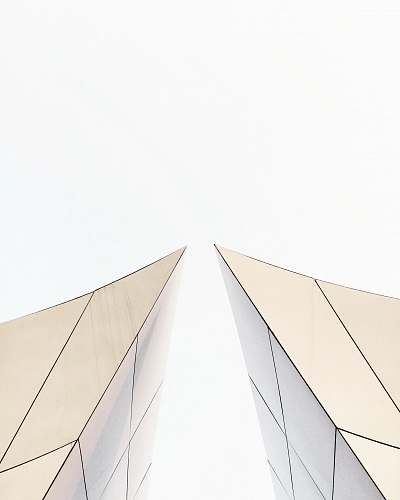 building two white buildings about to touch each other's peak architecture