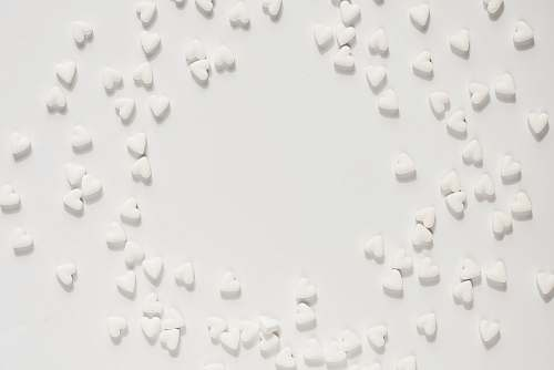 black-and-white white heart decors on white surface grey