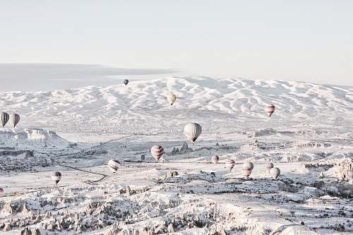photo grey assorted-color air balloons below snowland at daytime hot air balloon free for commercial use images
