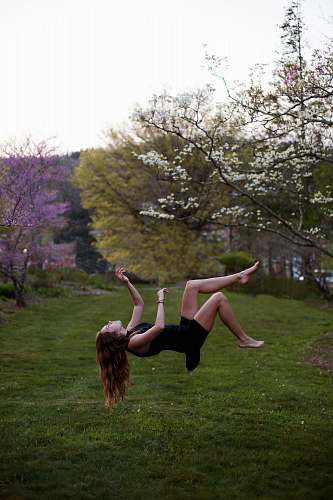 girl woman back flipping in the garden spring