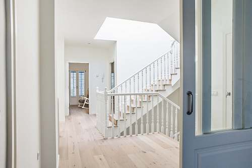 flooring white stairs near door hardwood