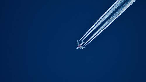 airplane aerial photo of airplane with contrail during daytime aircraft