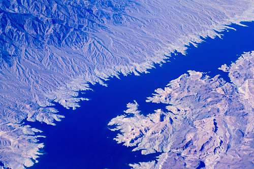 water aerial photo of body of water in between mountains grand canyon