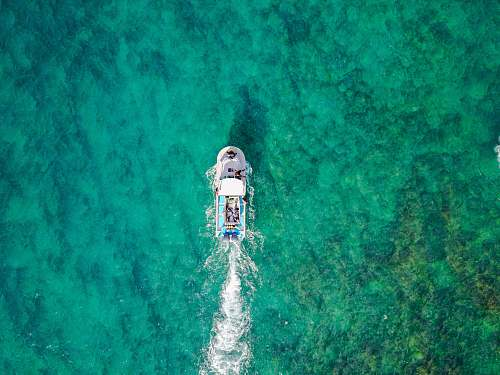 jesus aerial photo of white boat sailing on body of water at daytime united states