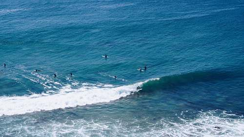 water aerial shot of person surfing on ocean ocean
