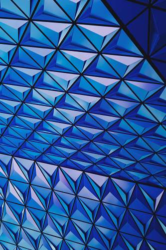 pattern architectural photography of blue glass celing triangle