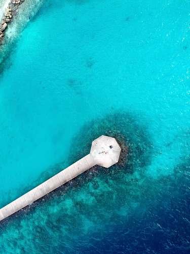 teal bird's eye view of sea dock aerial