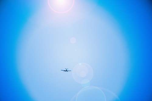 airplane black airplane flying on air lens flare