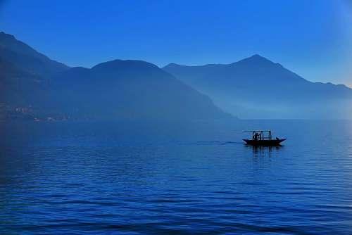 boat black boat in body of water nature
