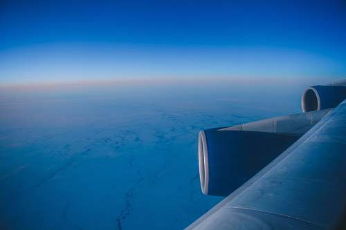 sky blue airplane wing