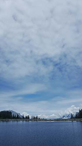 outdoors blue lake under white clouds nature