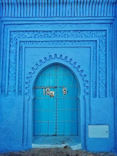 chefchaouen blue painted wall and door at daytime morocco