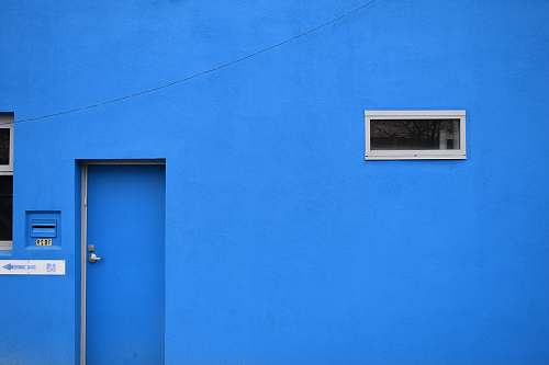 building blue painted wall close-up photography door
