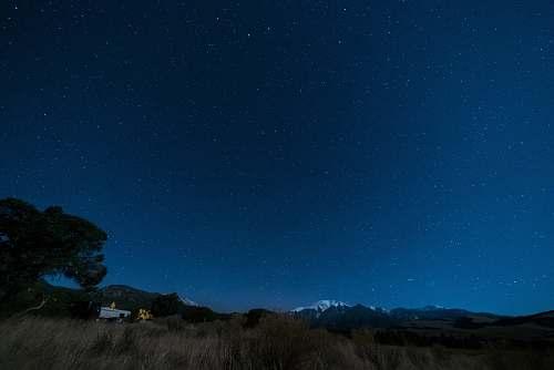 night blue starry skies camping