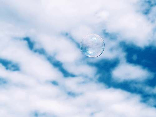 bubble bubble under white clouds at daytime ciutadella park
