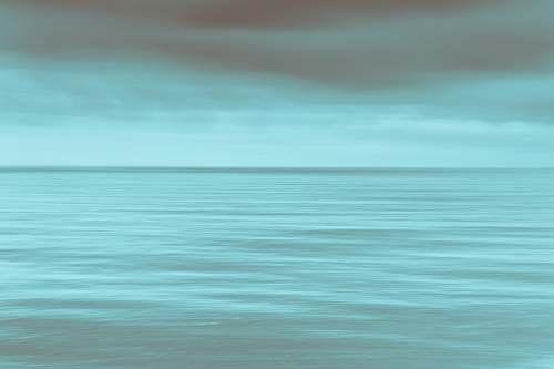 ocean calm sea under gray clouds sea