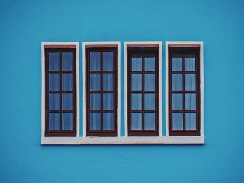 window clear glass windows in blue concrete wall cologne